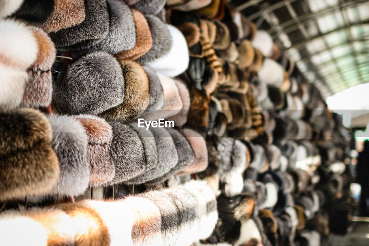 Fur Hats Hanging At Market For Sale