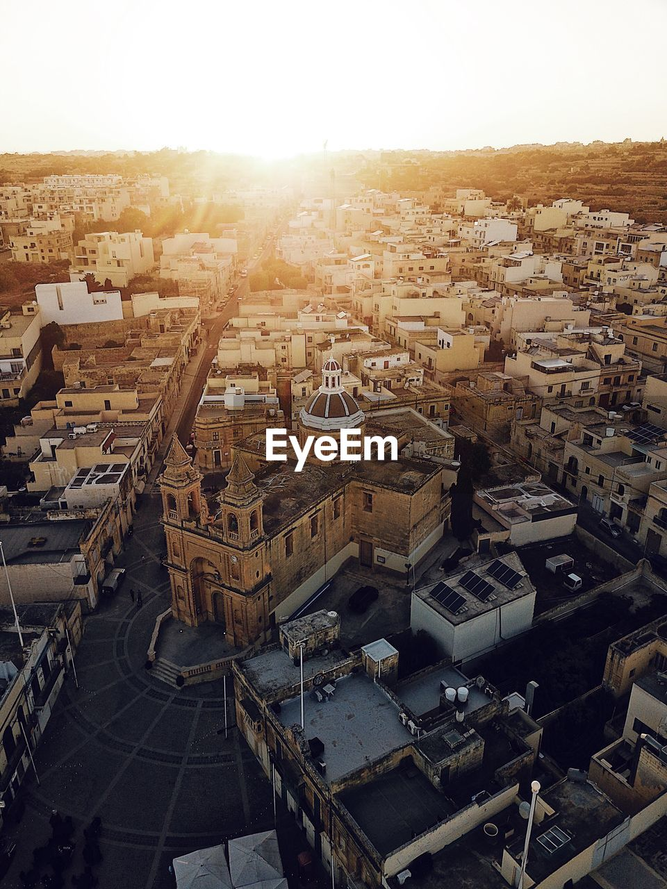 High Angle View Of Cityscape Against Clear Sky During Sunset