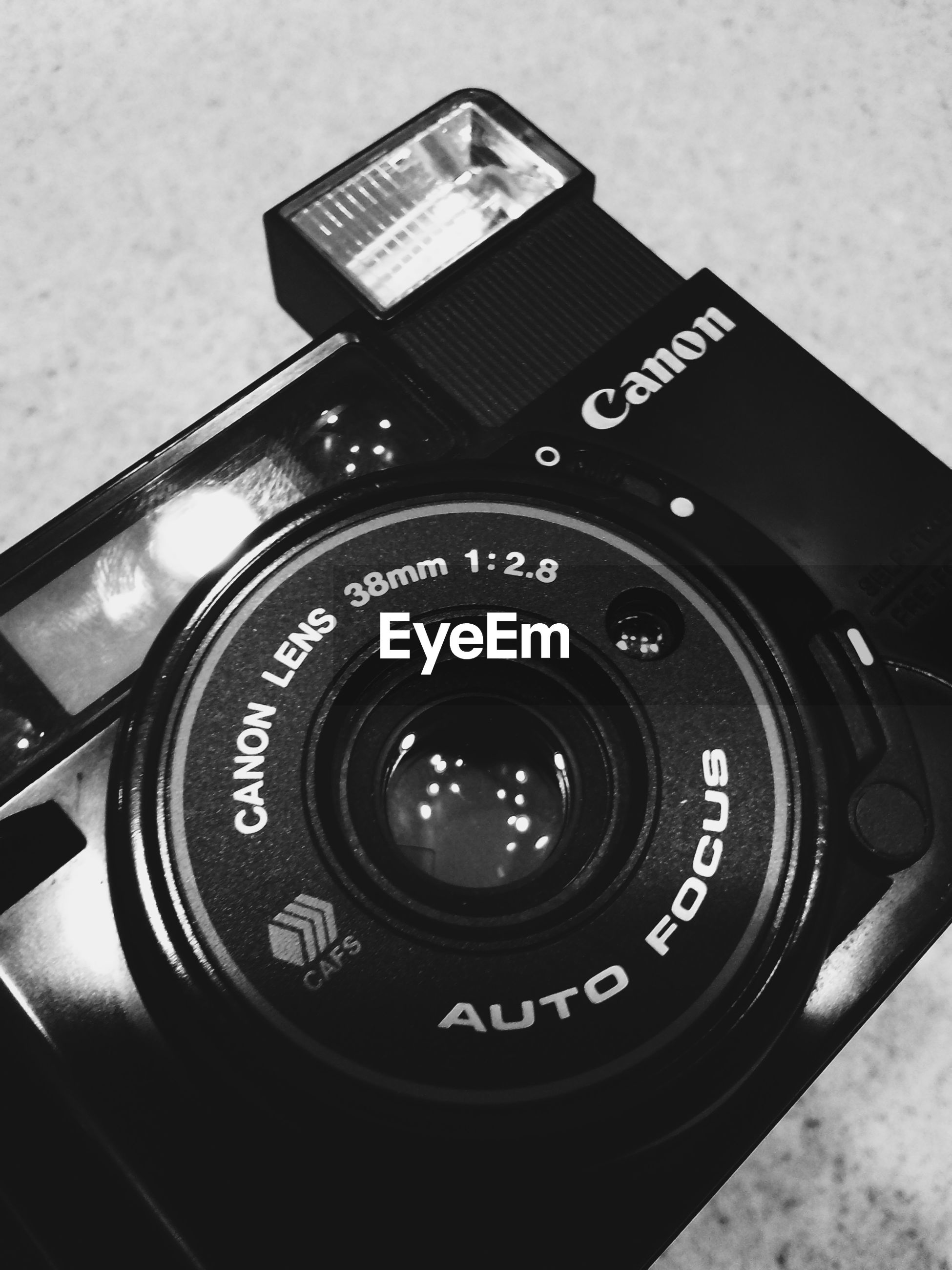technology, photography themes, indoors, camera - photographic equipment, close-up, retro styled, old-fashioned, communication, lens - optical instrument, digital camera, wireless technology, photographing, number, time, equipment, vintage, single object, antique, telephone, connection