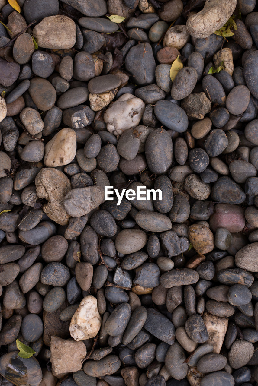 large group of objects, full frame, backgrounds, abundance, no people, stone - object, high angle view, day, rock, pebble, solid, food and drink, outdoors, stone, nature, textured, still life, food, freshness, directly above