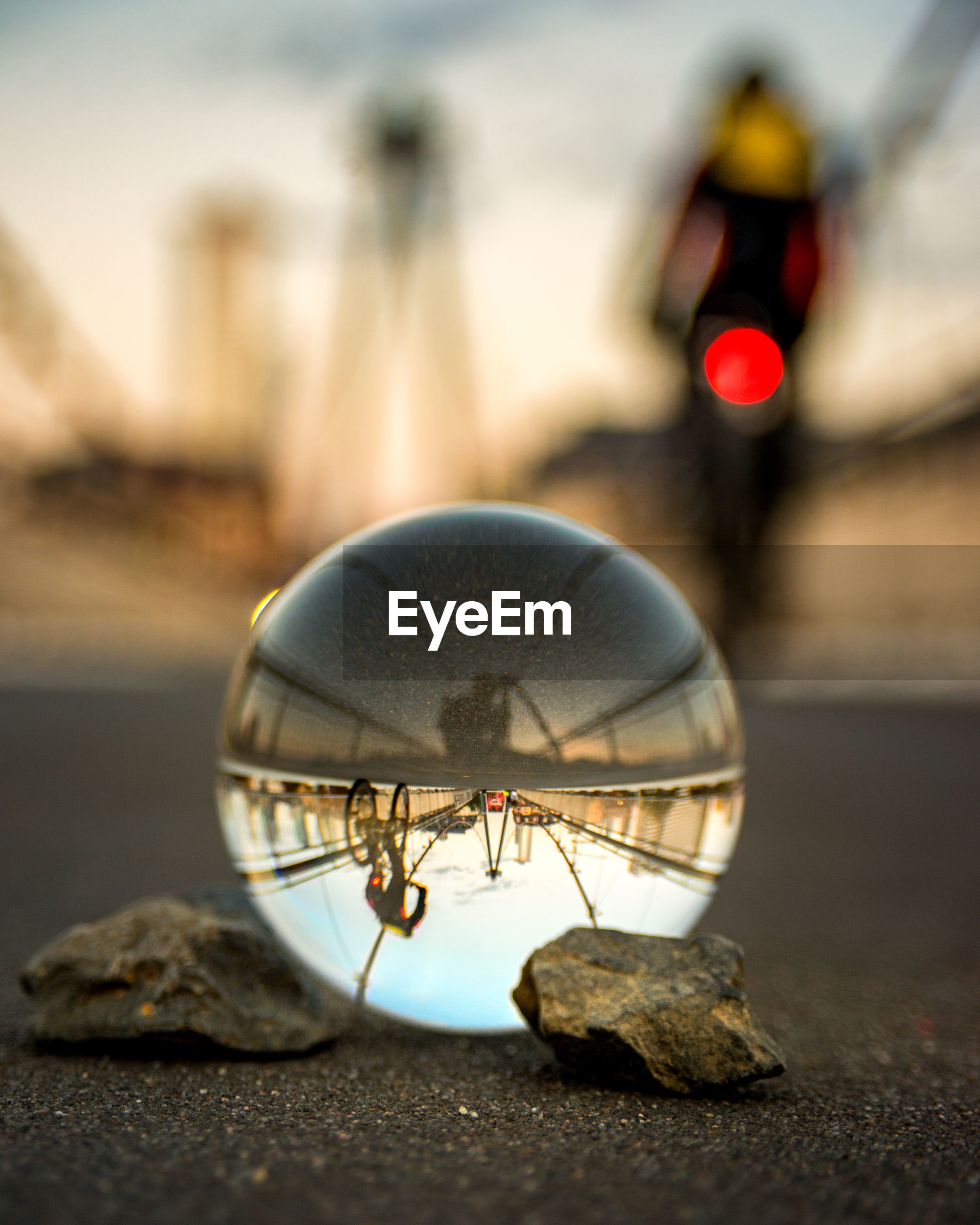 Close-up of crystal ball on bridge with reflection
