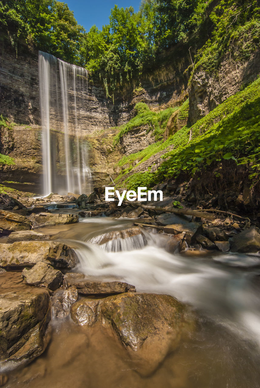 water, scenics - nature, long exposure, beauty in nature, motion, flowing water, waterfall, blurred motion, tree, rock, plant, nature, rock - object, solid, flowing, day, environment, land, forest, power in nature, no people, falling water, outdoors, running water, stream - flowing water, purity