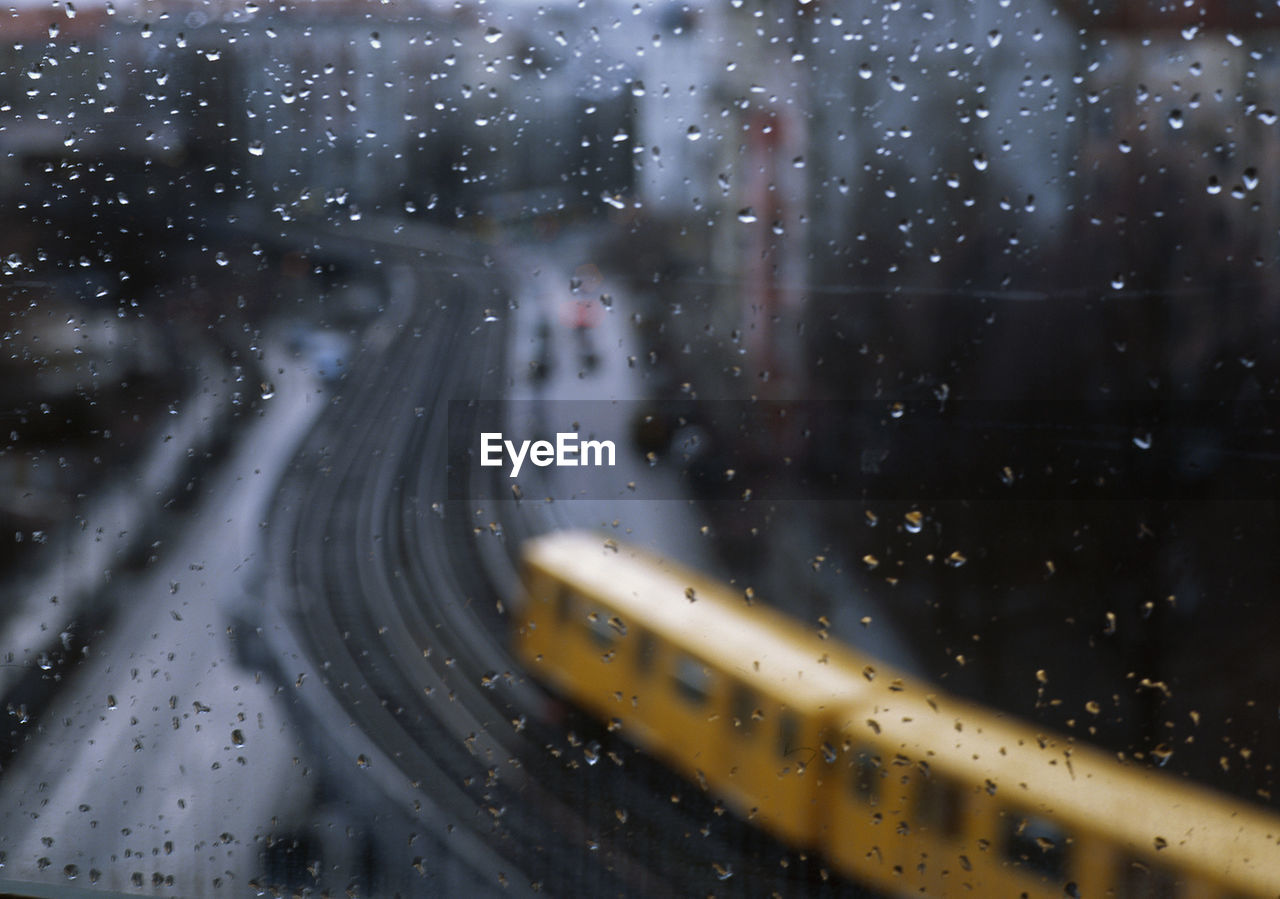 View Of Train Passing By Seen Through Window