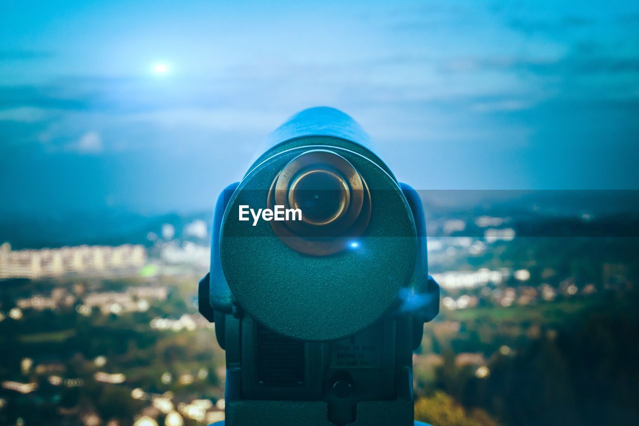 coin operated, binoculars, sky, focus on foreground, coin-operated binoculars, astronomy, surveillance, close-up, technology, nature, security, day, no people, outdoors, optical instrument, telescope, cloud - sky, architecture, landscape, environment, hand-held telescope