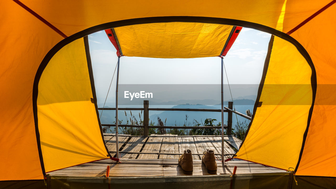 yellow, tent, no people, nature, day, shelter, outdoors, sunlight, beauty in nature, clear sky, sky, sea, water