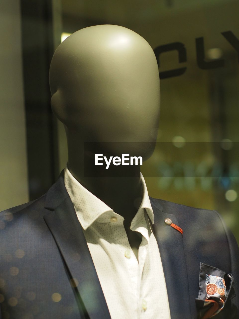one person, clothing, headshot, portrait, men, focus on foreground, uniform, real people, mannequin, glass - material, occupation, day, business, transparent, indoors, close-up, looking, suit, retail display, responsibility, government