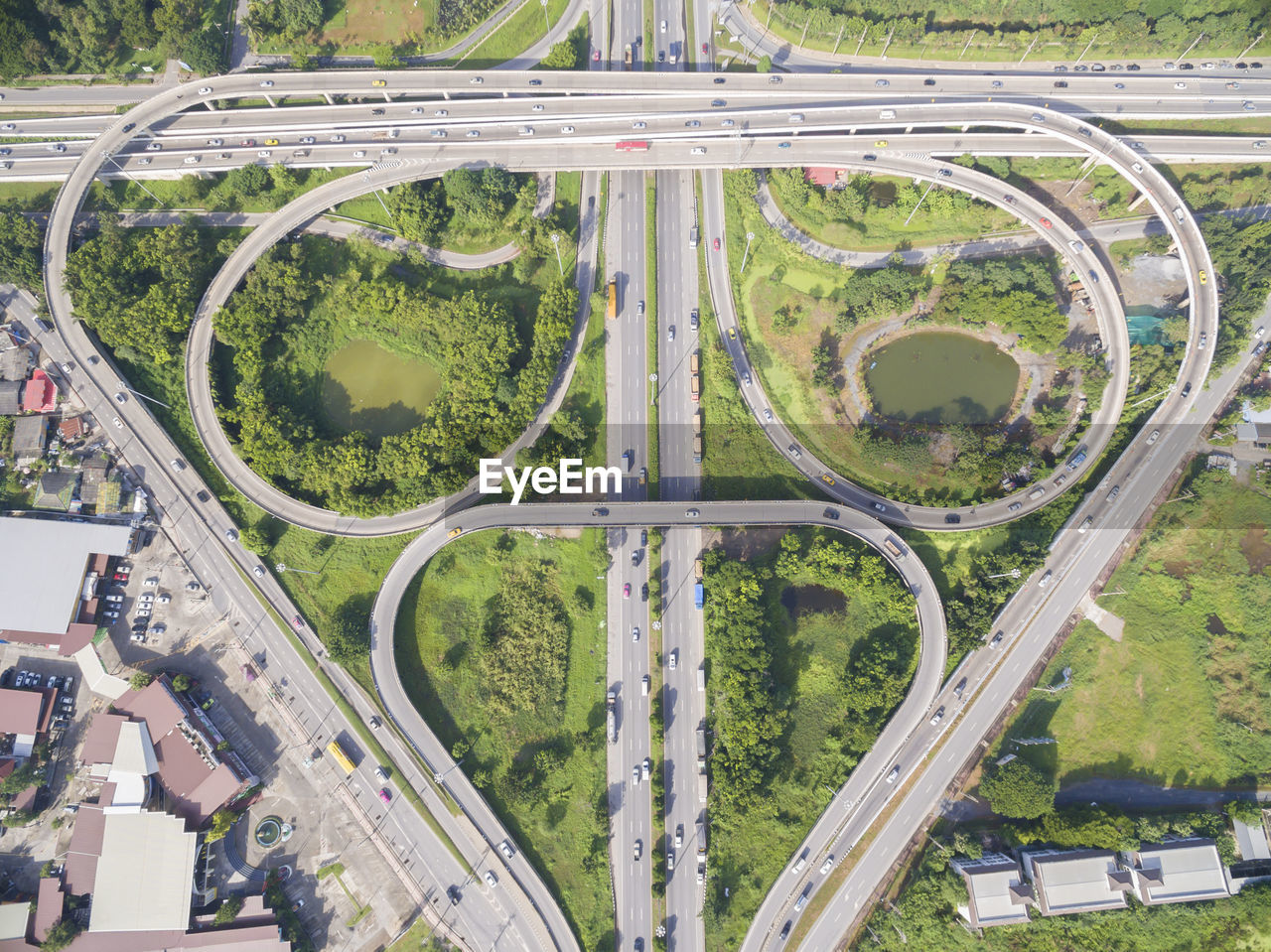 road, transportation, city, aerial view, high angle view, no people, built structure, day, architecture, plant, street, land vehicle, highway, mode of transportation, nature, multiple lane highway, green color, connection, elevated road, outdoors, overpass, complexity