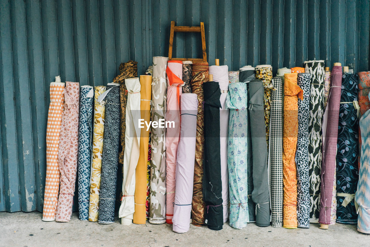 Multi Colored Fabric Rolls Against Wall