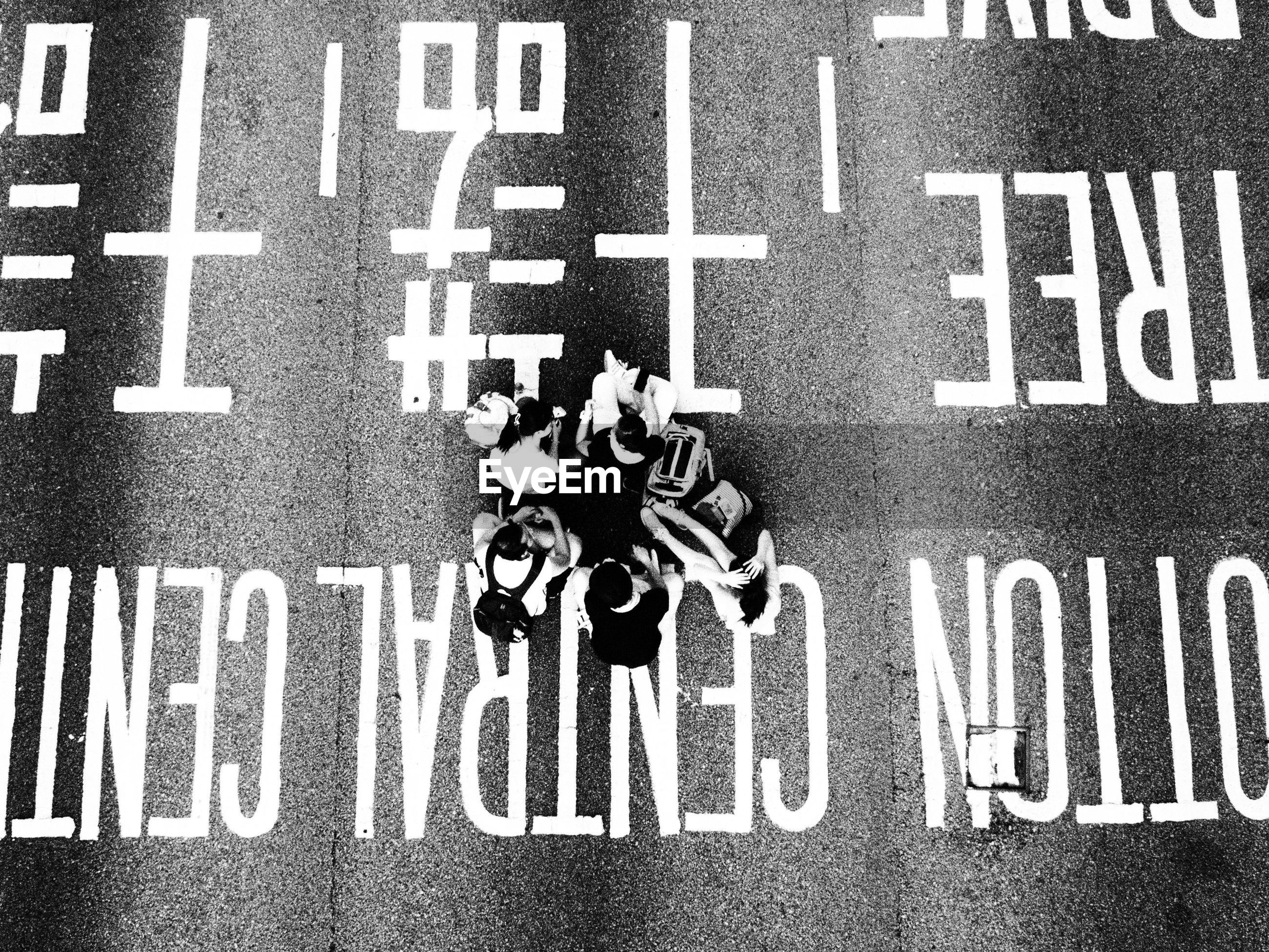 High angle view of people on road with text