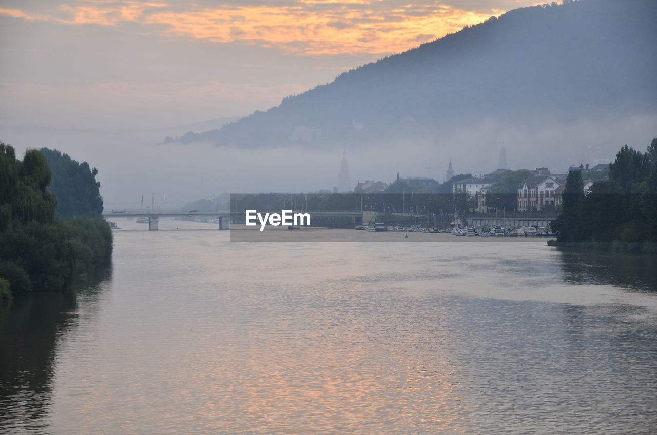 water, river, waterfront, sky, nature, beauty in nature, scenics, built structure, sunset, tranquil scene, architecture, no people, cloud - sky, outdoors, bridge - man made structure, tranquility, tree, day, building exterior