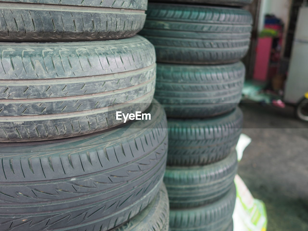 stack, large group of objects, no people, balance, tire, abundance, arrangement, pile, indoors, day, close-up