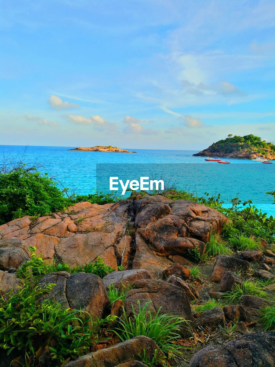 sky, water, scenics - nature, sea, tranquility, beauty in nature, tranquil scene, rock, land, nature, plant, solid, rock - object, no people, cloud - sky, horizon over water, beach, horizon, day, outdoors, turquoise colored