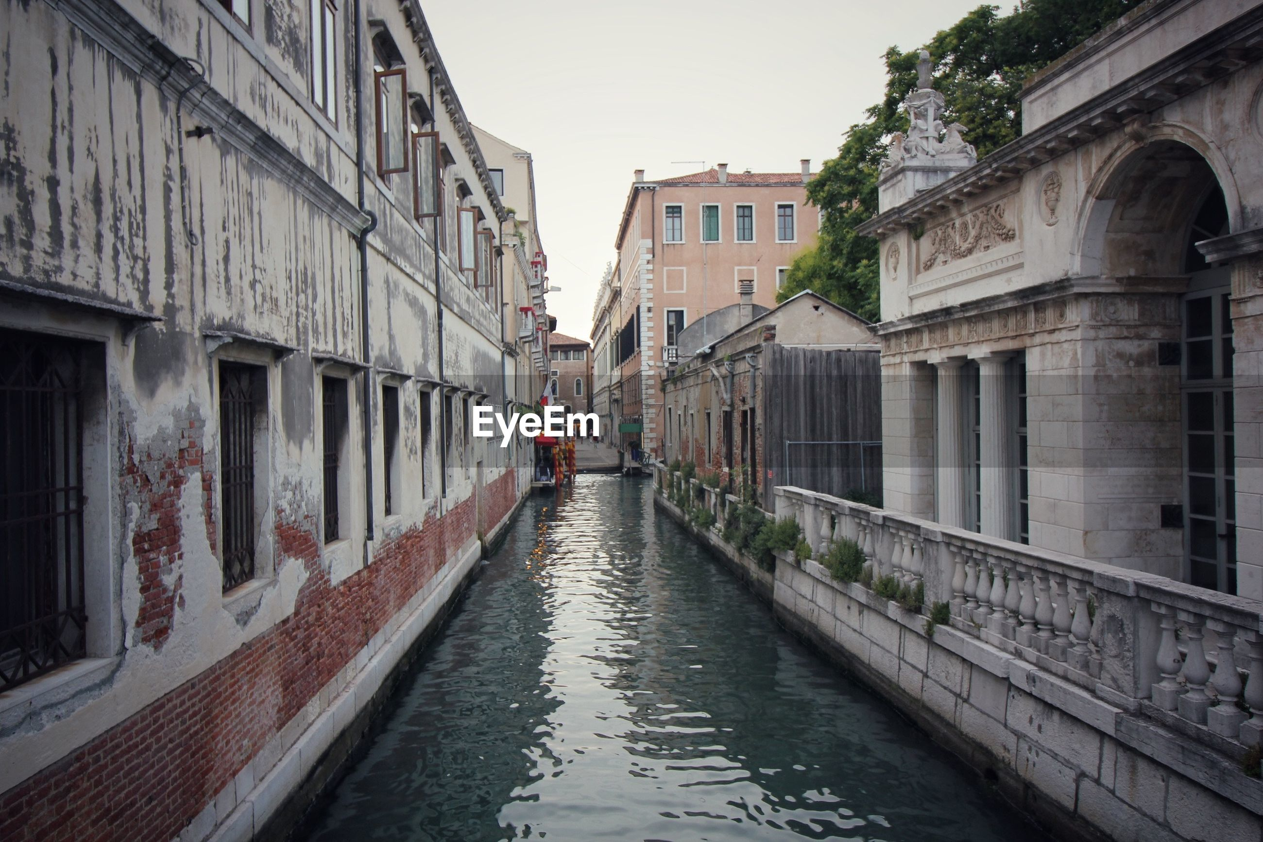 Canal amidst residential buildings
