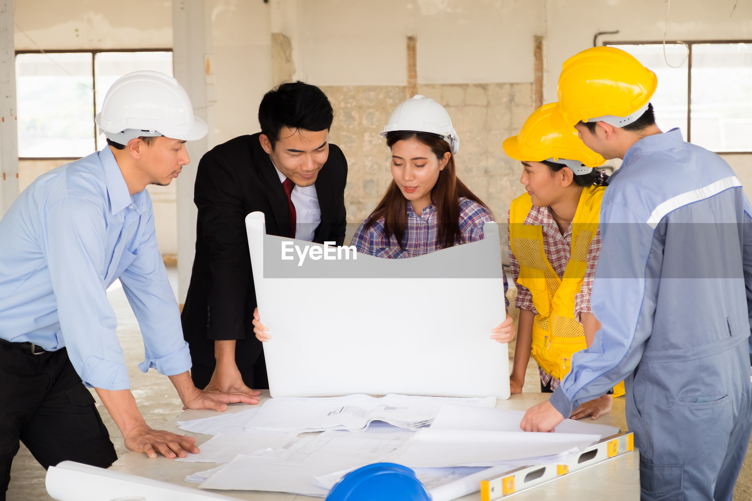 People working on table at construction site