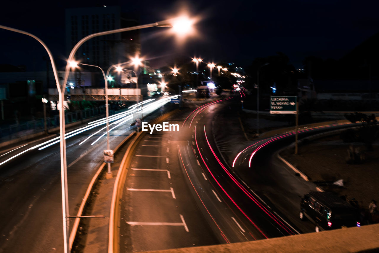 illuminated, night, light trail, speed, motion, long exposure, transportation, road, blurred motion, traffic, high street, street light, outdoors, no people, city