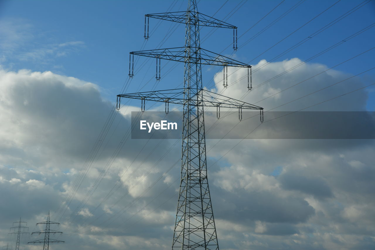 cloud - sky, technology, sky, electricity, connection, fuel and power generation, power supply, low angle view, power line, electricity pylon, cable, nature, no people, tall - high, outdoors, day, tower, metal, built structure, communication, electrical equipment, global communications