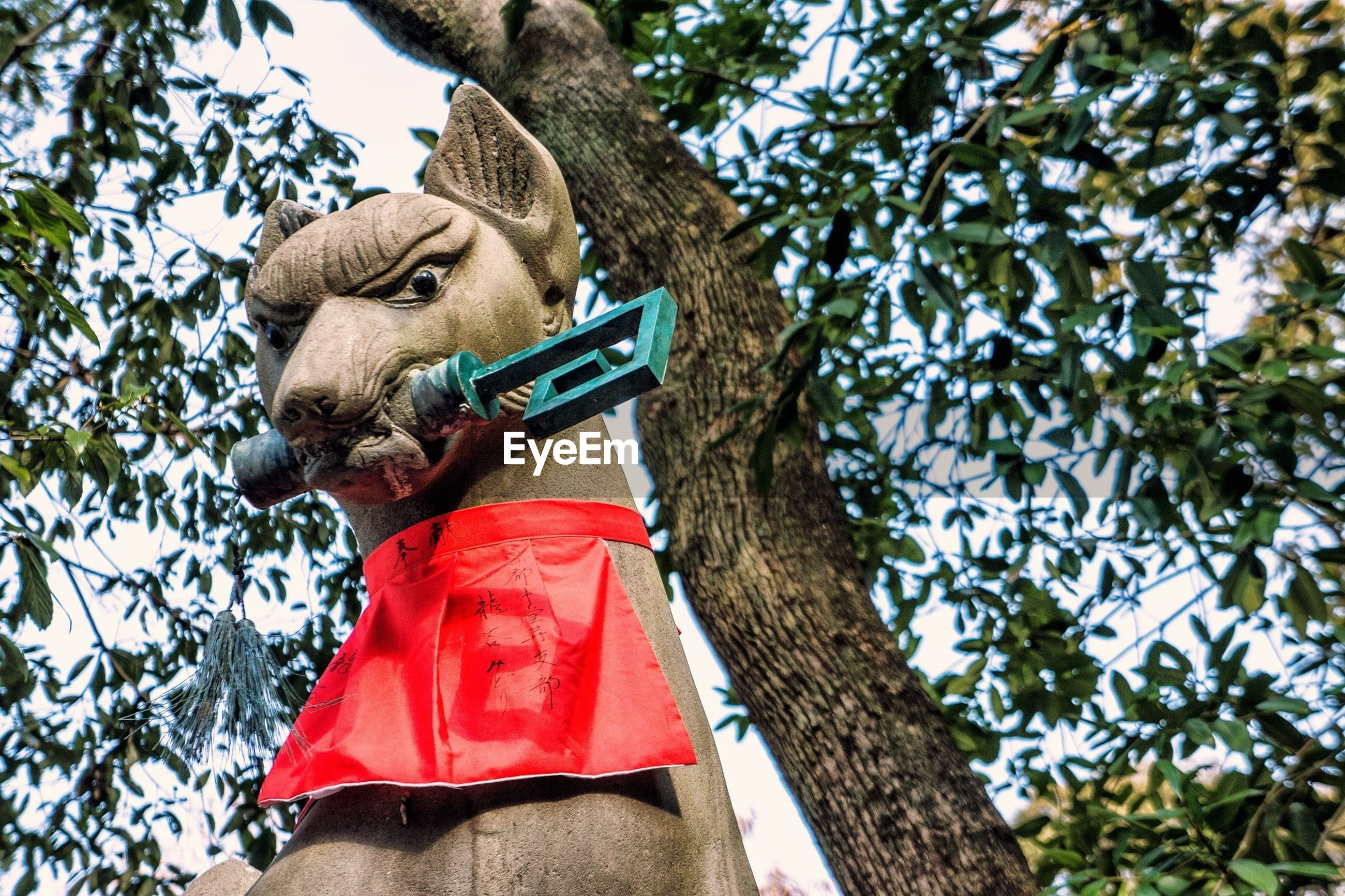 statue, sculpture, low angle view, tree, human representation, art, art and craft, animal representation, creativity, one animal, day, bird, outdoors, branch, animal themes, wildlife, animals in the wild, no people