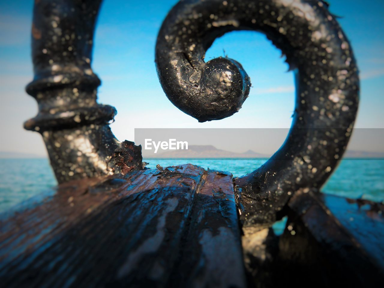 sea, metal, water, rusty, outdoors, no people, day, close-up, nature, textured, sky, beauty in nature, blue, horizon over water, nautical vessel