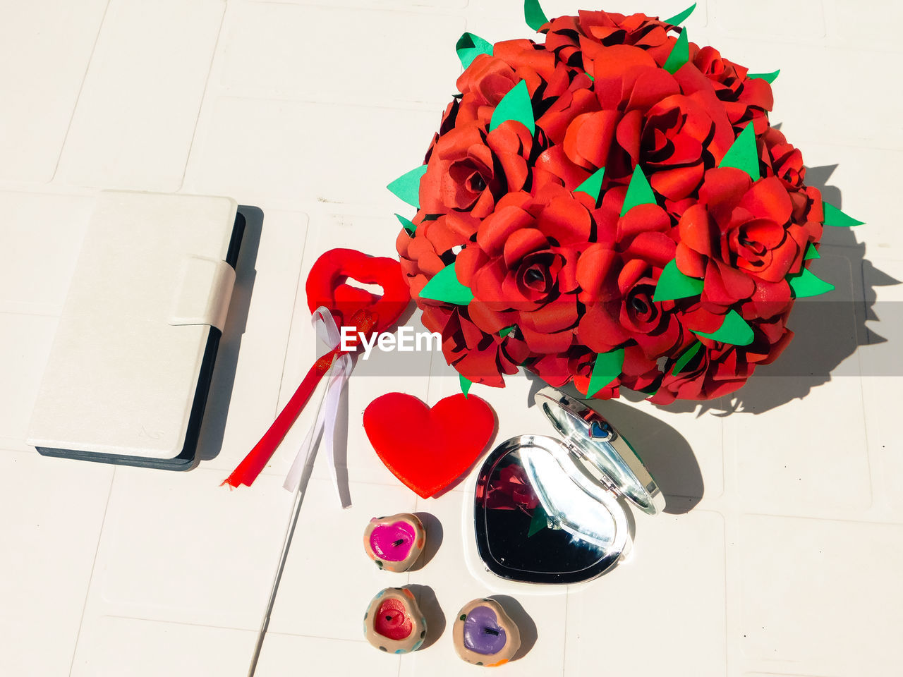 red, flower, table, indoors, high angle view, rose - flower, no people, petal, freshness, close-up, fragility, day, flower head
