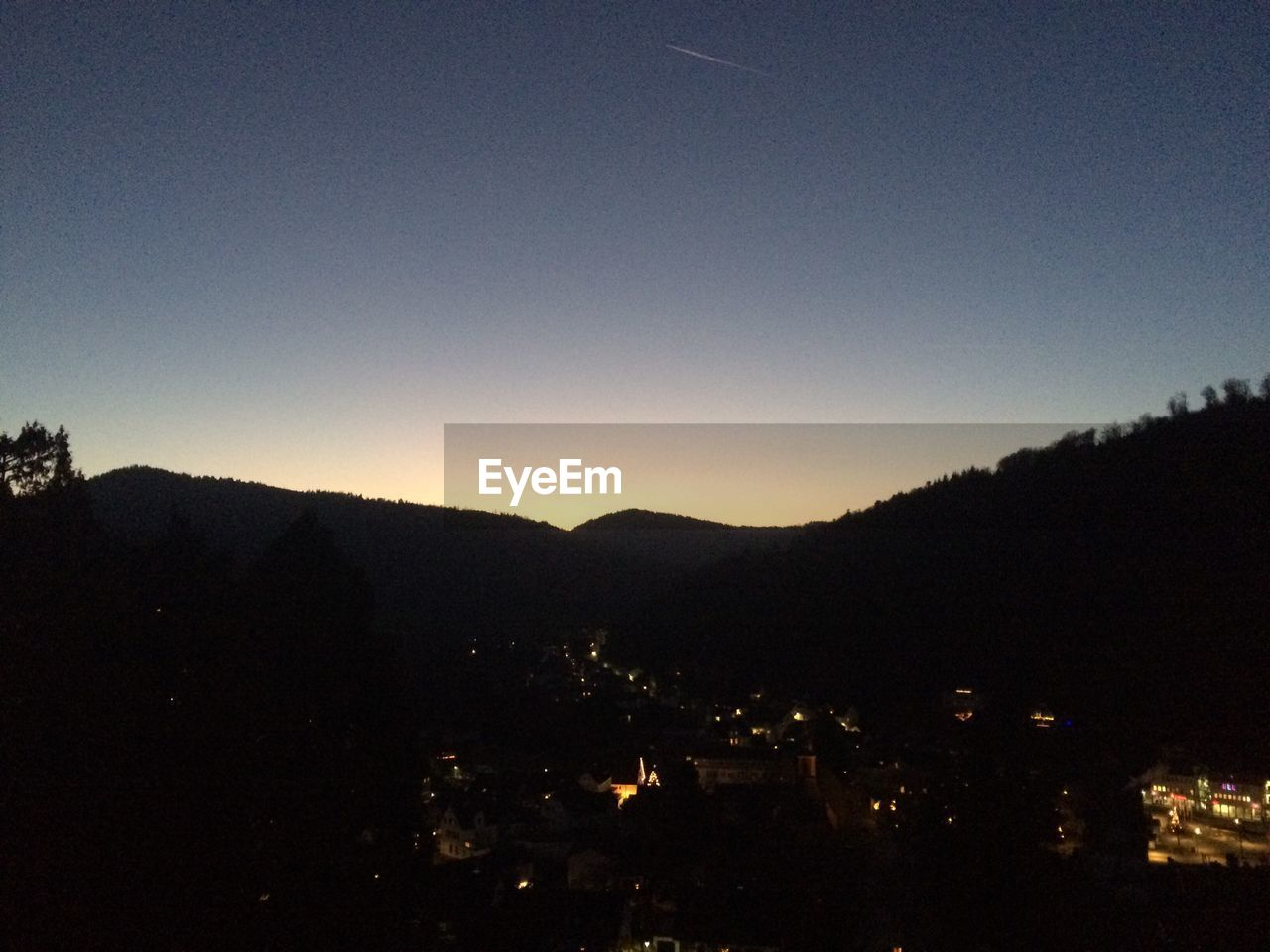 silhouette, night, mountain, no people, clear sky, nature, outdoors, building exterior, architecture, sunset, sky, city