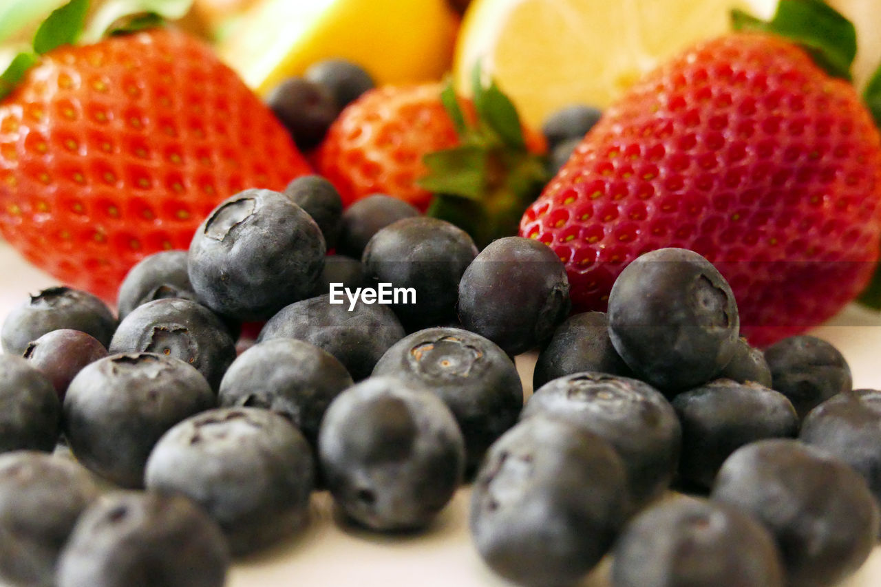 fruit, food and drink, healthy eating, berry fruit, food, wellbeing, strawberry, freshness, selective focus, still life, close-up, blueberry, large group of objects, no people, red, indoors, choice, juicy, ripe, abundance