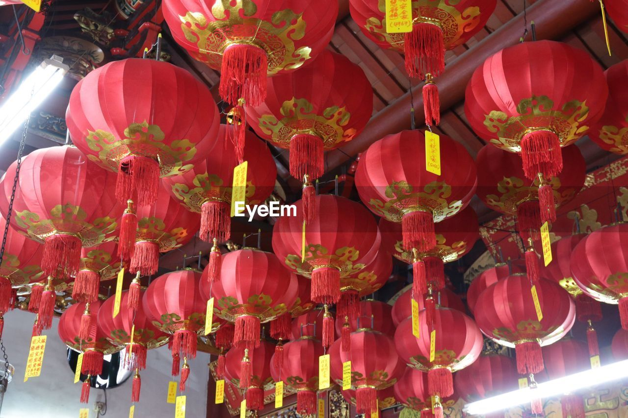 Low angle view of chinese lanterns hanging on roof