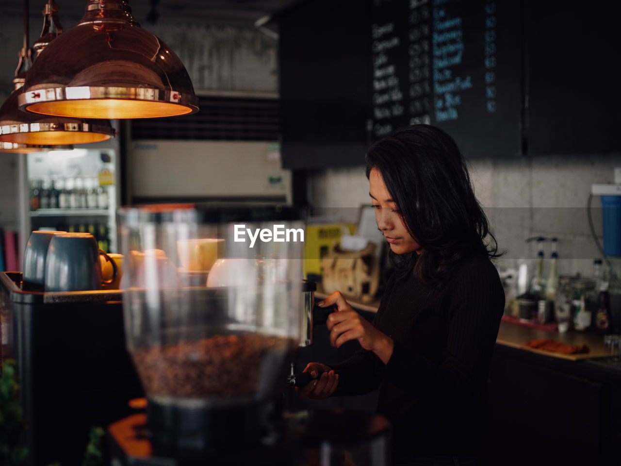 Barista Working In Cafe
