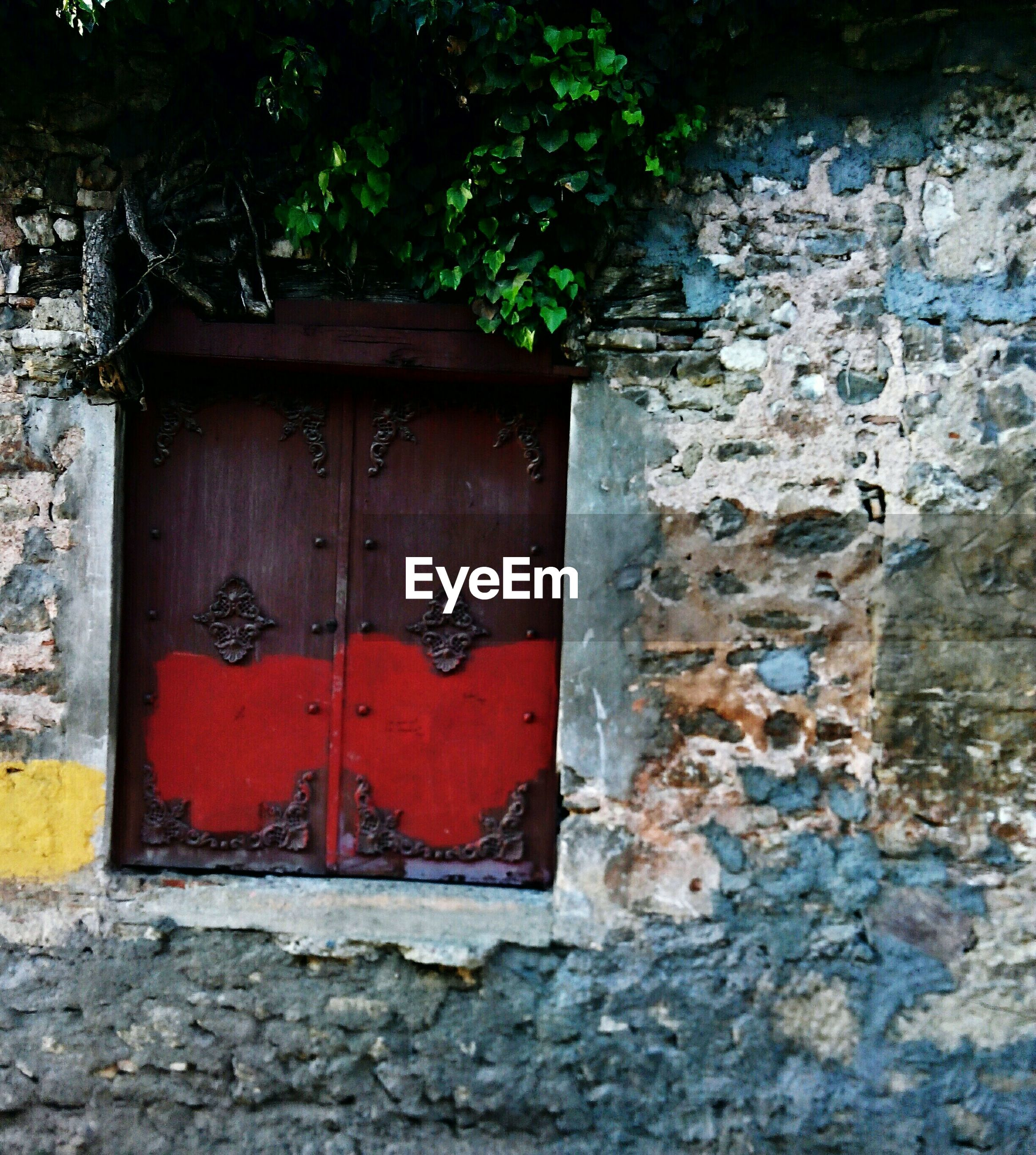 built structure, architecture, building exterior, door, closed, weathered, old, house, red, wall - building feature, entrance, brick wall, wood - material, safety, wall, protection, stone wall, residential structure, outdoors, window