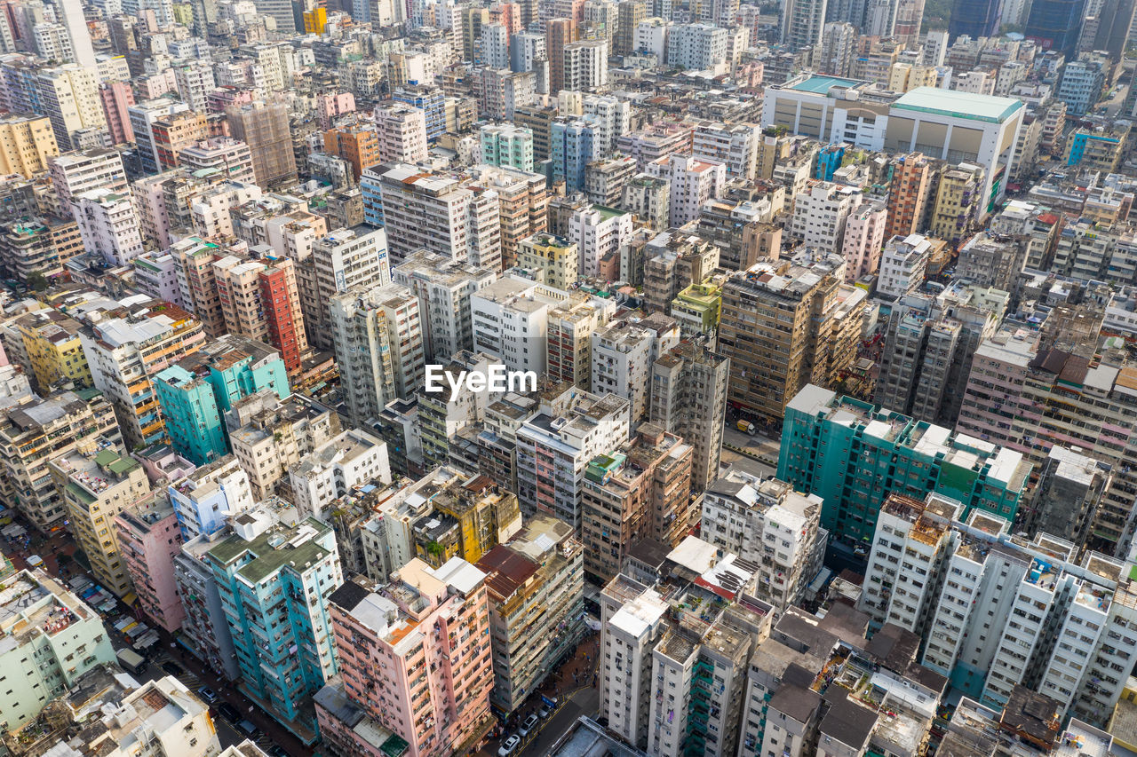 building exterior, cityscape, city, building, architecture, office building exterior, built structure, skyscraper, high angle view, aerial view, modern, tower, residential district, city life, crowd, crowded, landscape, day, downtown district, travel destinations, outdoors