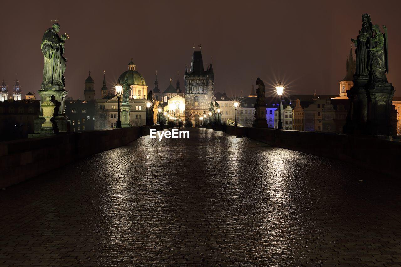 Illuminated charles bridge in city at night