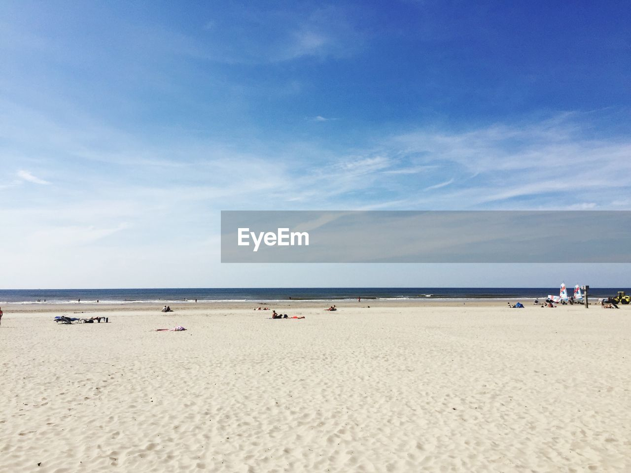 beach, sand, sea, sky, water, horizon over water, nature, tranquility, tranquil scene, scenics, blue, beauty in nature, incidental people, day, outdoors, cloud - sky, vacations, people