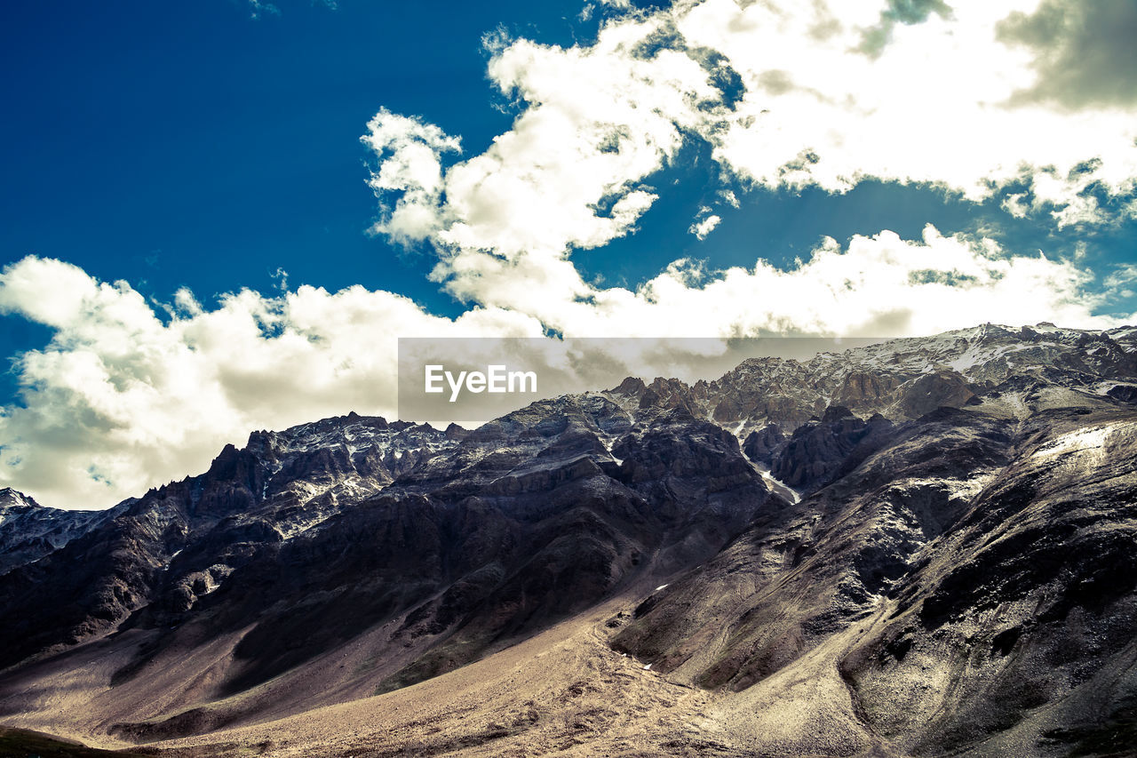 cloud - sky, sky, mountain, beauty in nature, scenics - nature, tranquil scene, tranquility, non-urban scene, mountain range, landscape, environment, nature, day, no people, rock, physical geography, geology, idyllic, remote, outdoors, formation, snowcapped mountain, arid climate, mountain peak, mountain ridge