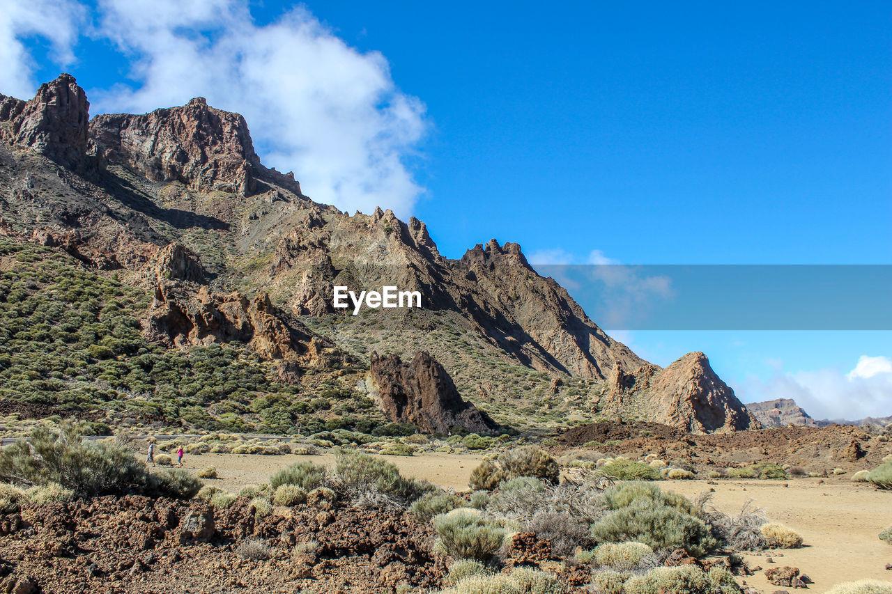 Rock formations on landscape against sky