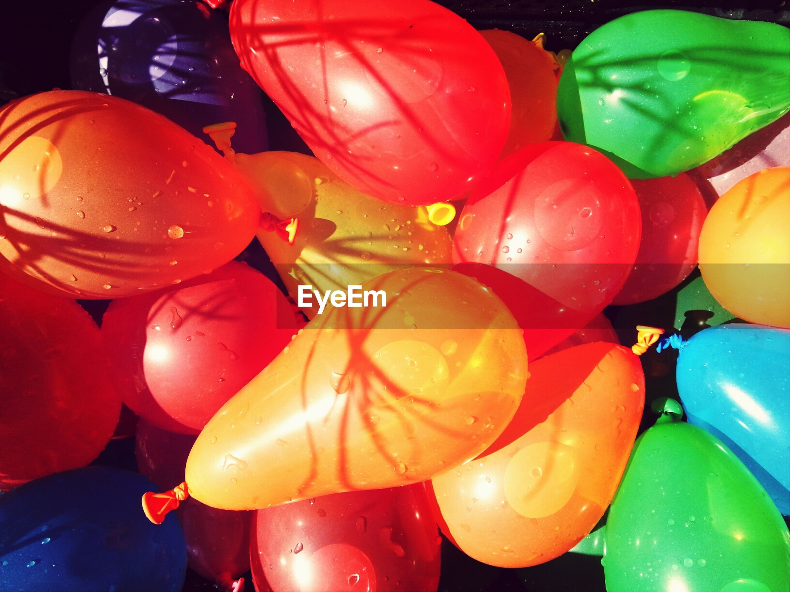 Close-up view of bunch of colorful balloons