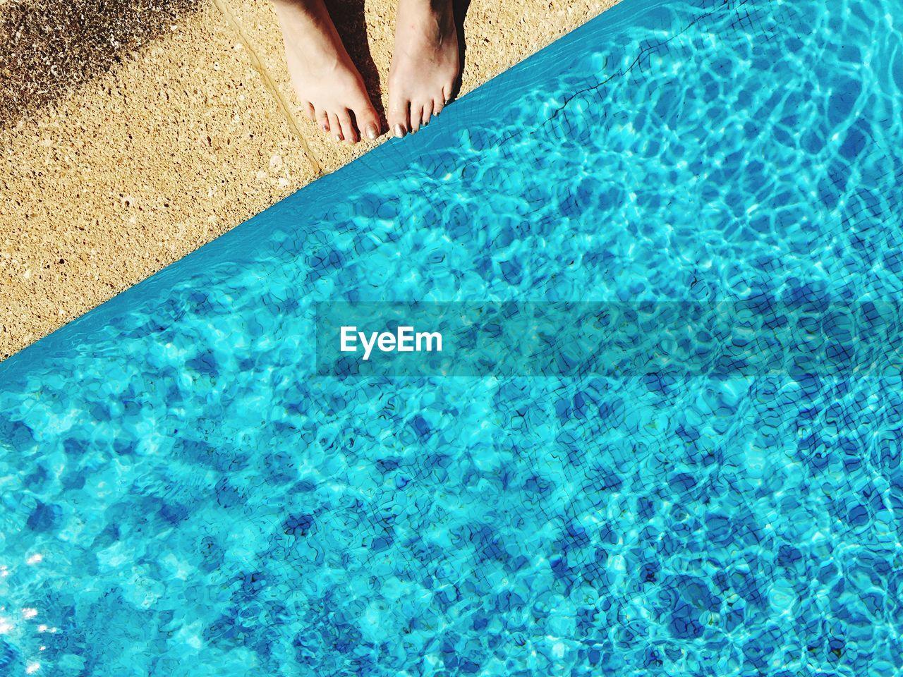 Human leg by pool