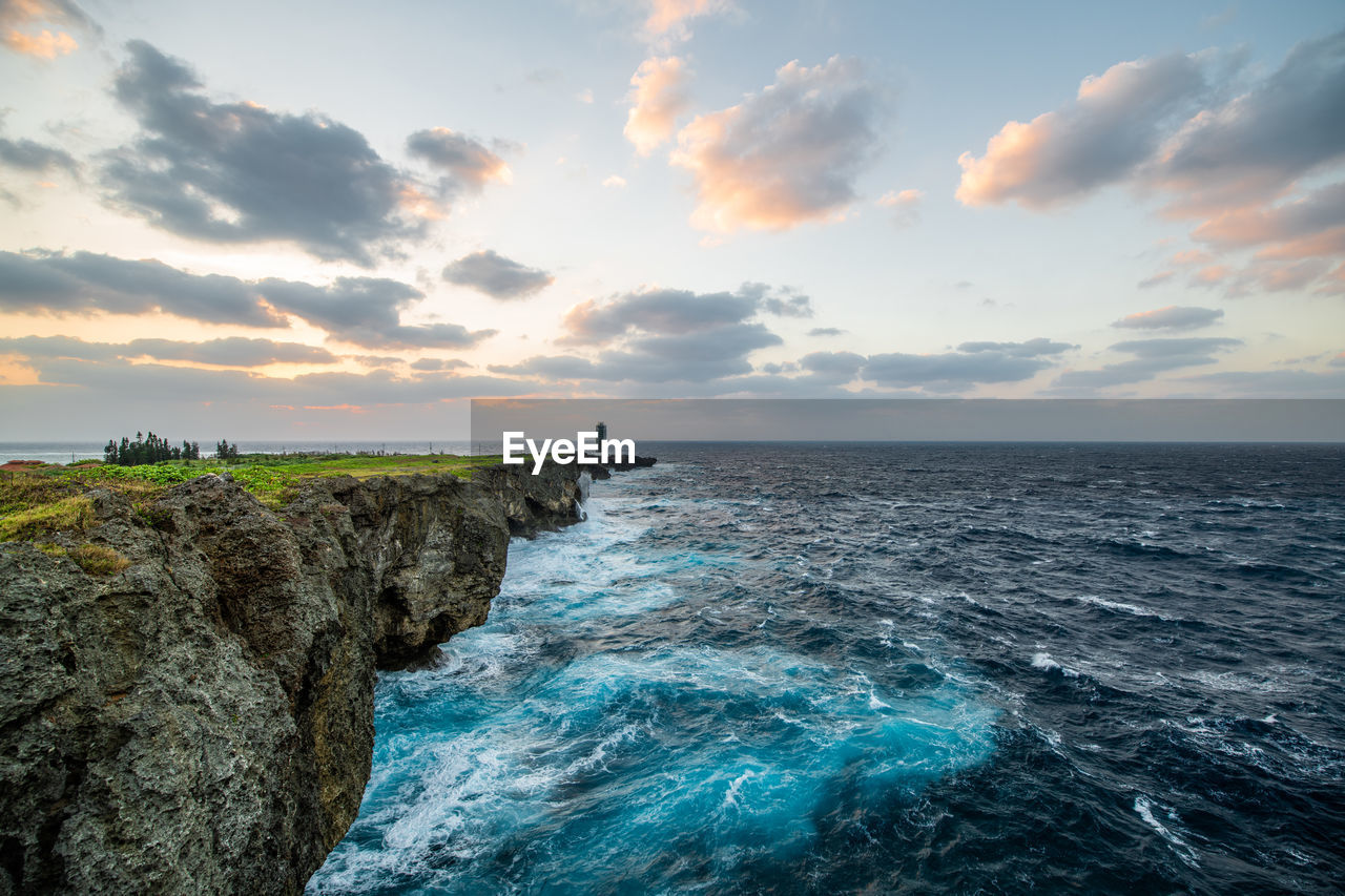 sky, sea, water, scenics - nature, cloud - sky, beauty in nature, horizon, horizon over water, sunset, solid, rock, non-urban scene, rock - object, tranquil scene, nature, idyllic, tranquility, no people, land, rocky coastline