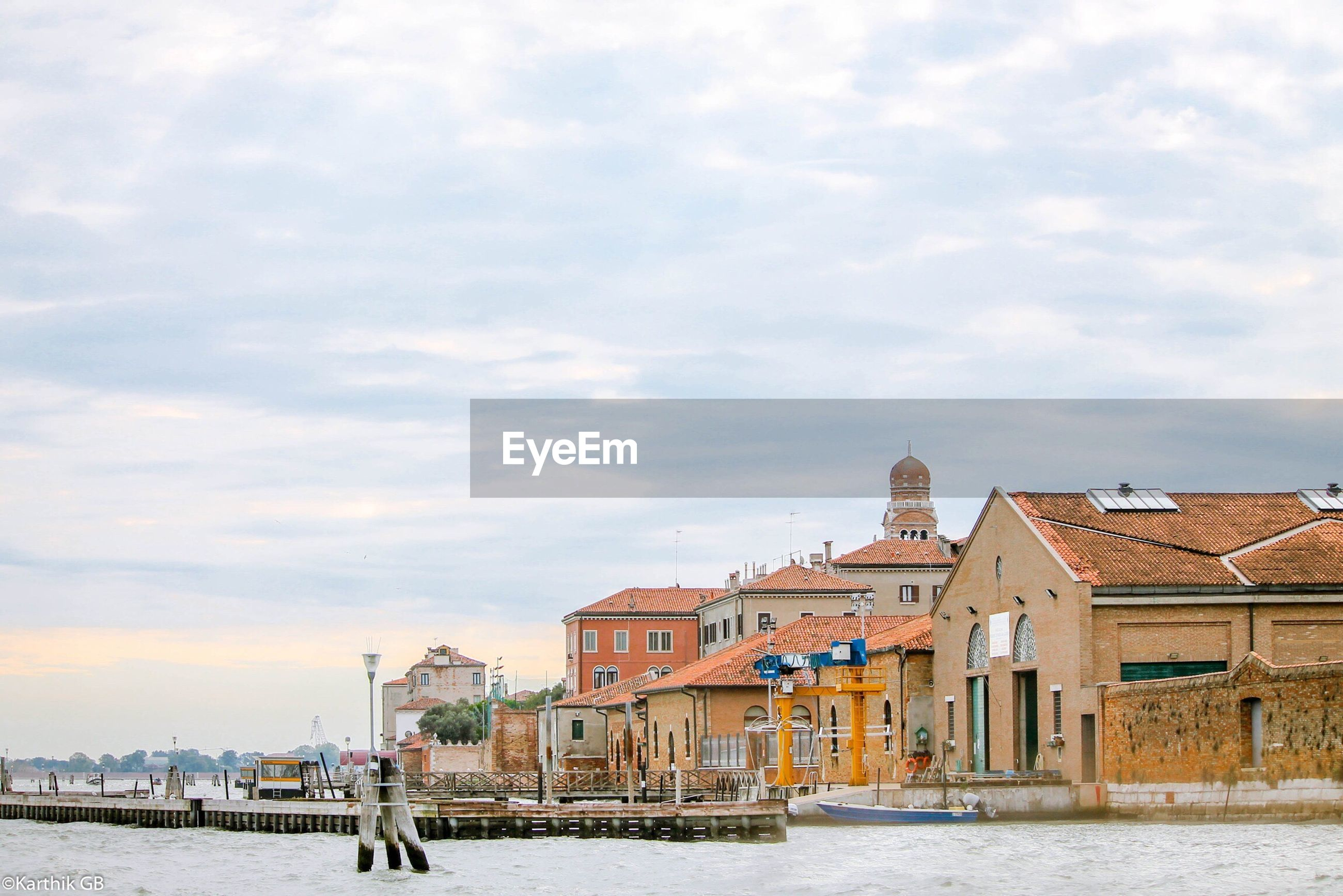 View of venice waterfront against cloudy sky