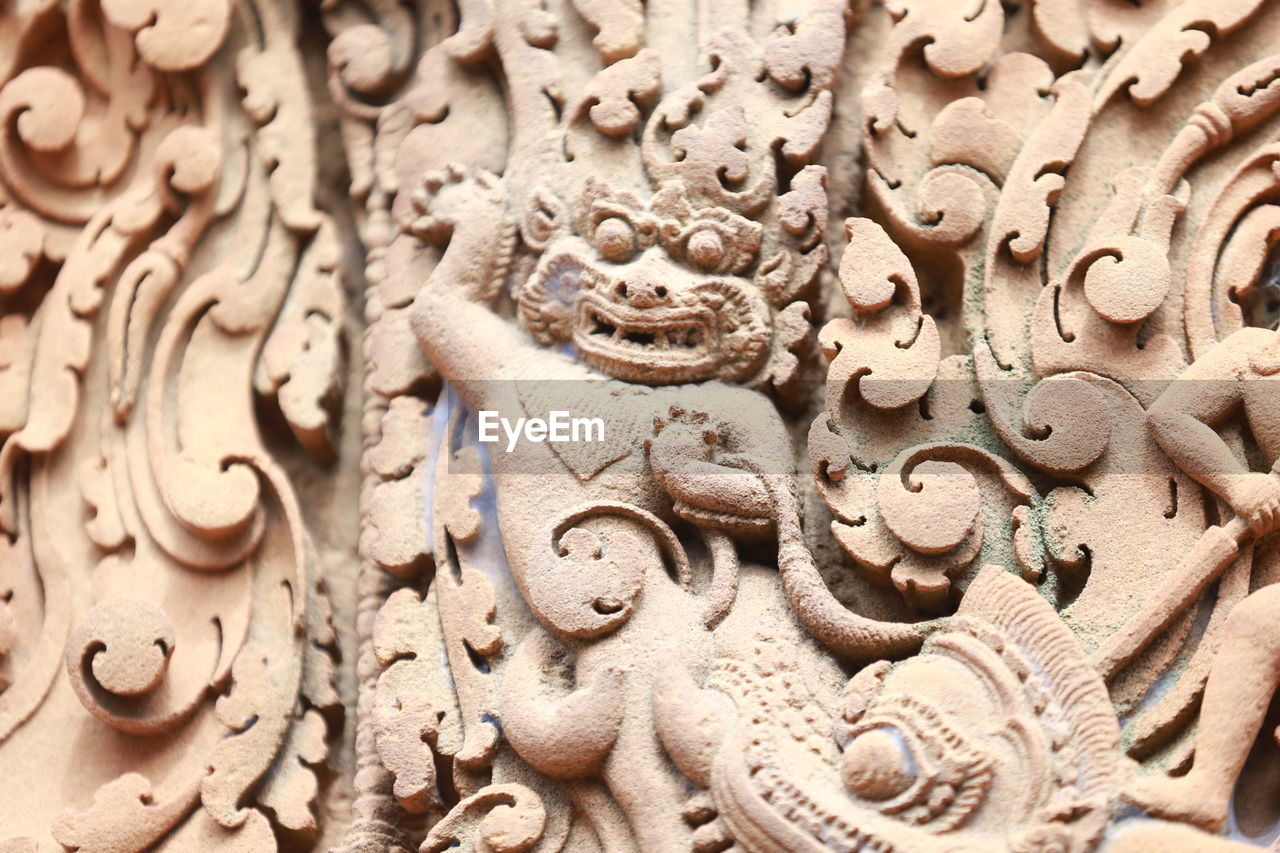 art and craft, full frame, craft, creativity, representation, close-up, sculpture, no people, religion, carving - craft product, selective focus, backgrounds, human representation, belief, spirituality, pattern, architecture, place of worship, indoors, ornate