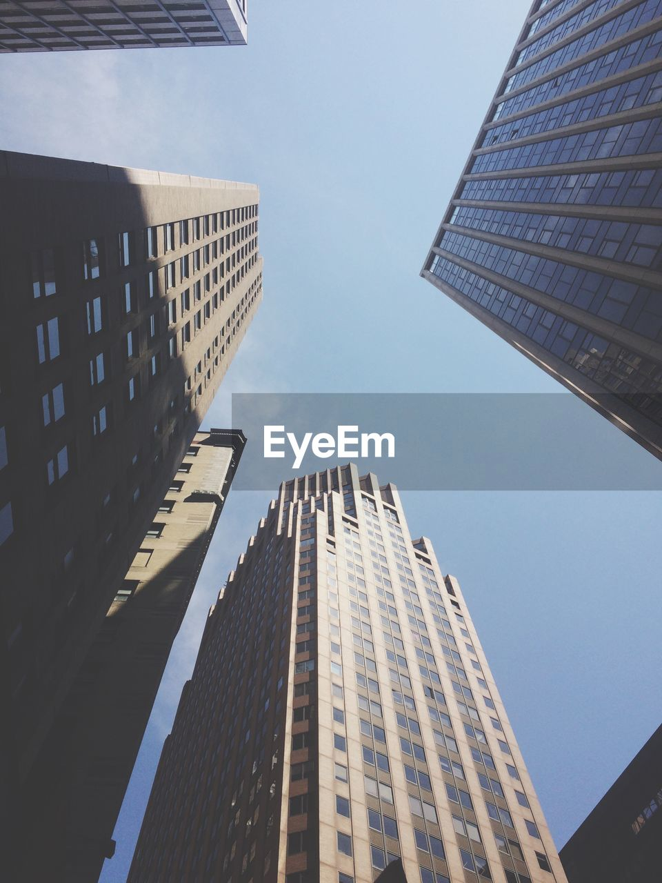 building exterior, built structure, architecture, city, building, office building exterior, low angle view, tall - high, sky, skyscraper, modern, no people, office, tower, nature, day, city life, clear sky, outdoors, glass - material, directly below, financial district