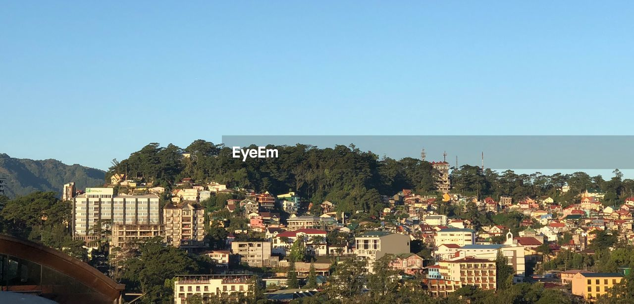 View Of Townscape Against Clear Blue Sky
