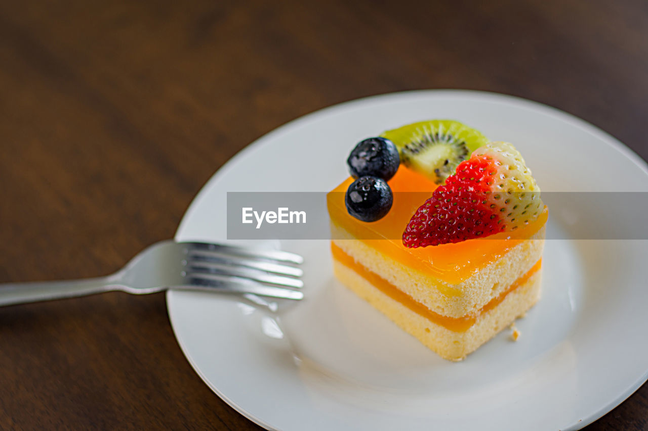 eating utensil, food, kitchen utensil, food and drink, freshness, dessert, table, ready-to-eat, fork, sweet food, sweet, plate, indulgence, berry fruit, cake, fruit, temptation, still life, close-up, slice, no people, slice of cake, cheesecake, tart - dessert, snack