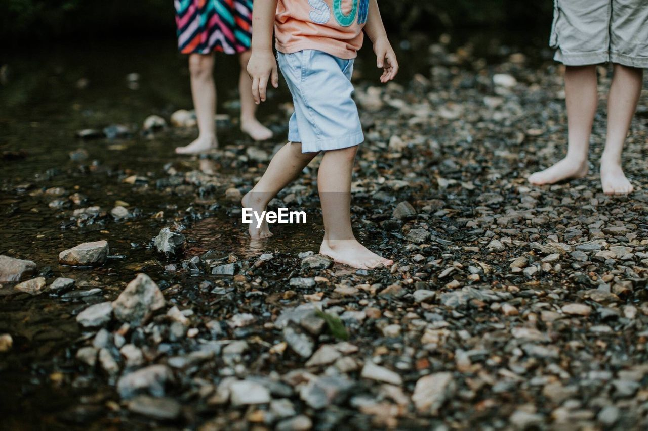 Low Section Of Barefoot Children