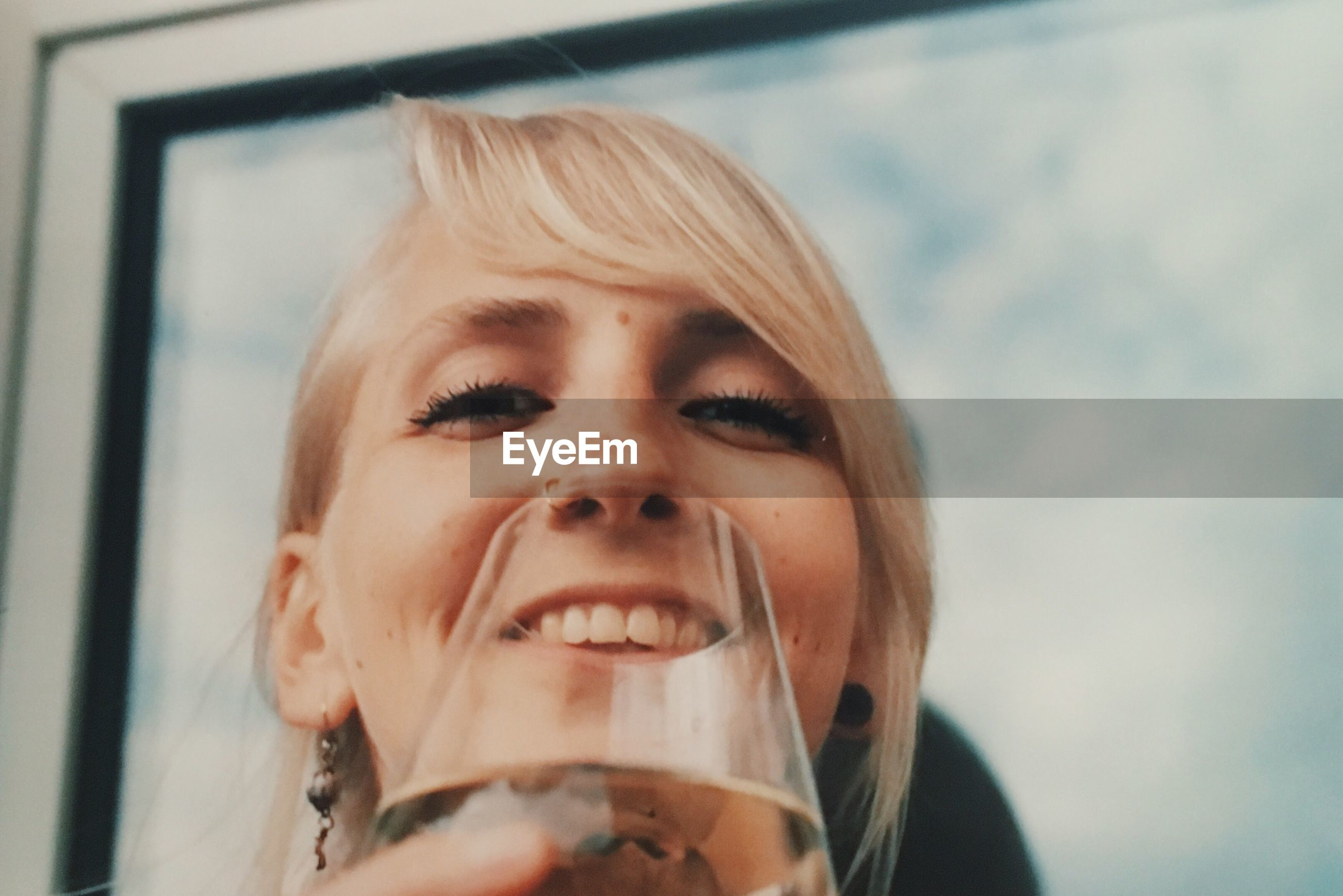 headshot, front view, one person, close-up, drink, refreshment, real people, day, drinking, food and drink, happiness, smiling, low angle view, alcohol, outdoors, lifestyles, young adult, people