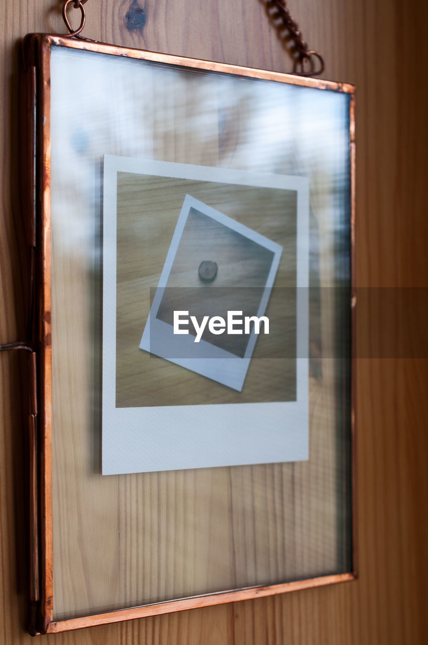wood - material, photography themes, indoors, frame, picture frame, no people, wall - building feature, communication, table, directly above, close-up, shape, architecture, focus on foreground, museum, technology, creativity, design, square shape, blank