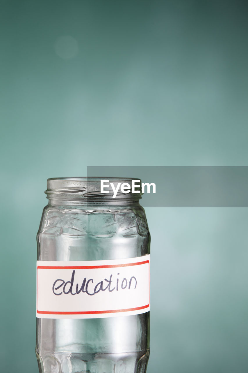 Close-up of education text on glass jar