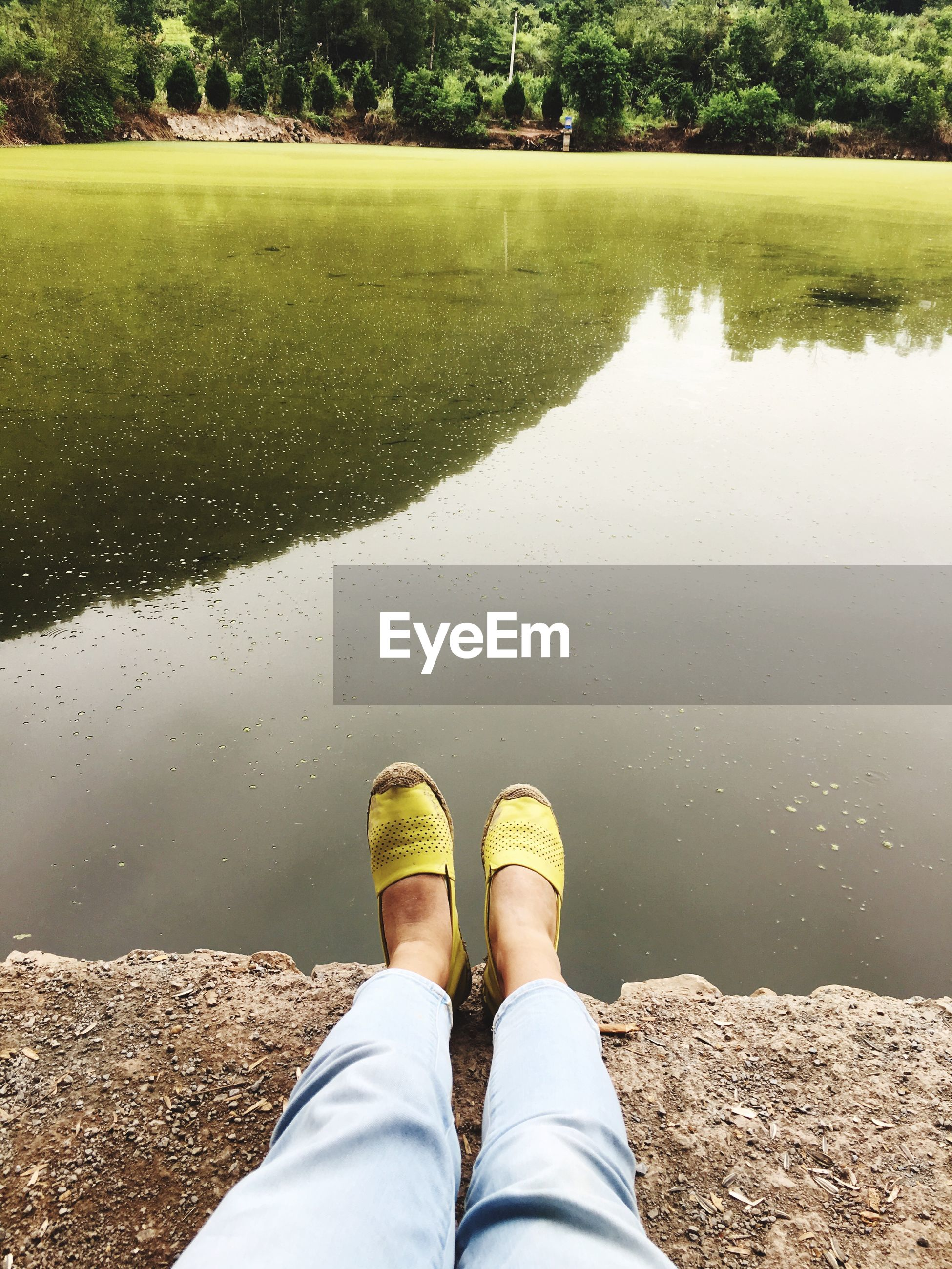 low section, person, water, standing, personal perspective, footwear, reflection, day, relaxation, outdoors, limb, standing water, tranquility, vibrant color