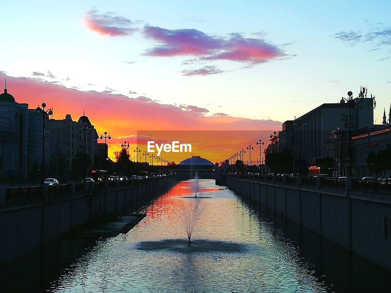 architecture, built structure, sunset, building exterior, water, bridge - man made structure, sky, river, orange color, connection, city, waterfront, cloud - sky, no people, outdoors, travel destinations, nature, day