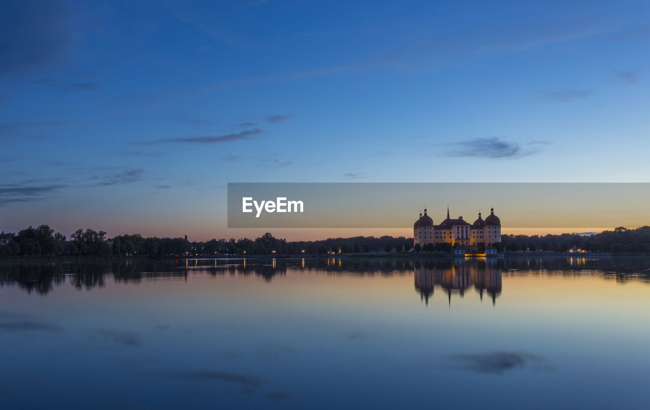 sky, building exterior, water, built structure, architecture, waterfront, reflection, sunset, travel destinations, nature, city, river, no people, cloud - sky, building, illuminated, travel, government