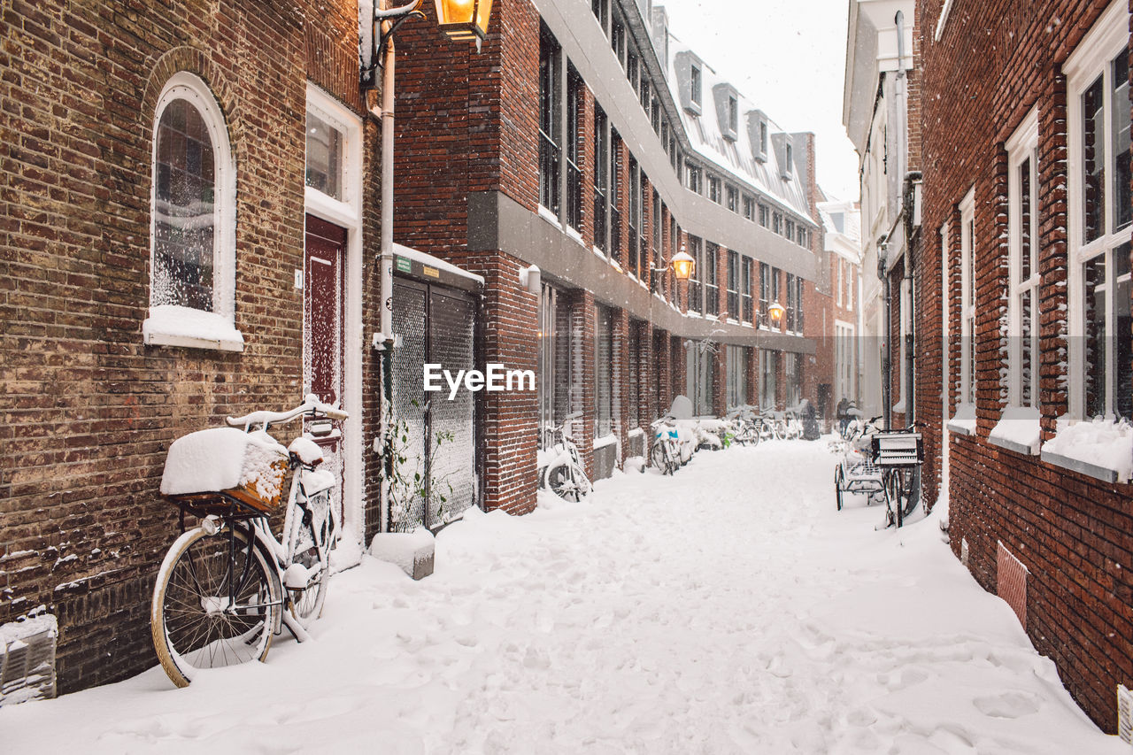 CITY STREET AMIDST BUILDINGS DURING WINTER