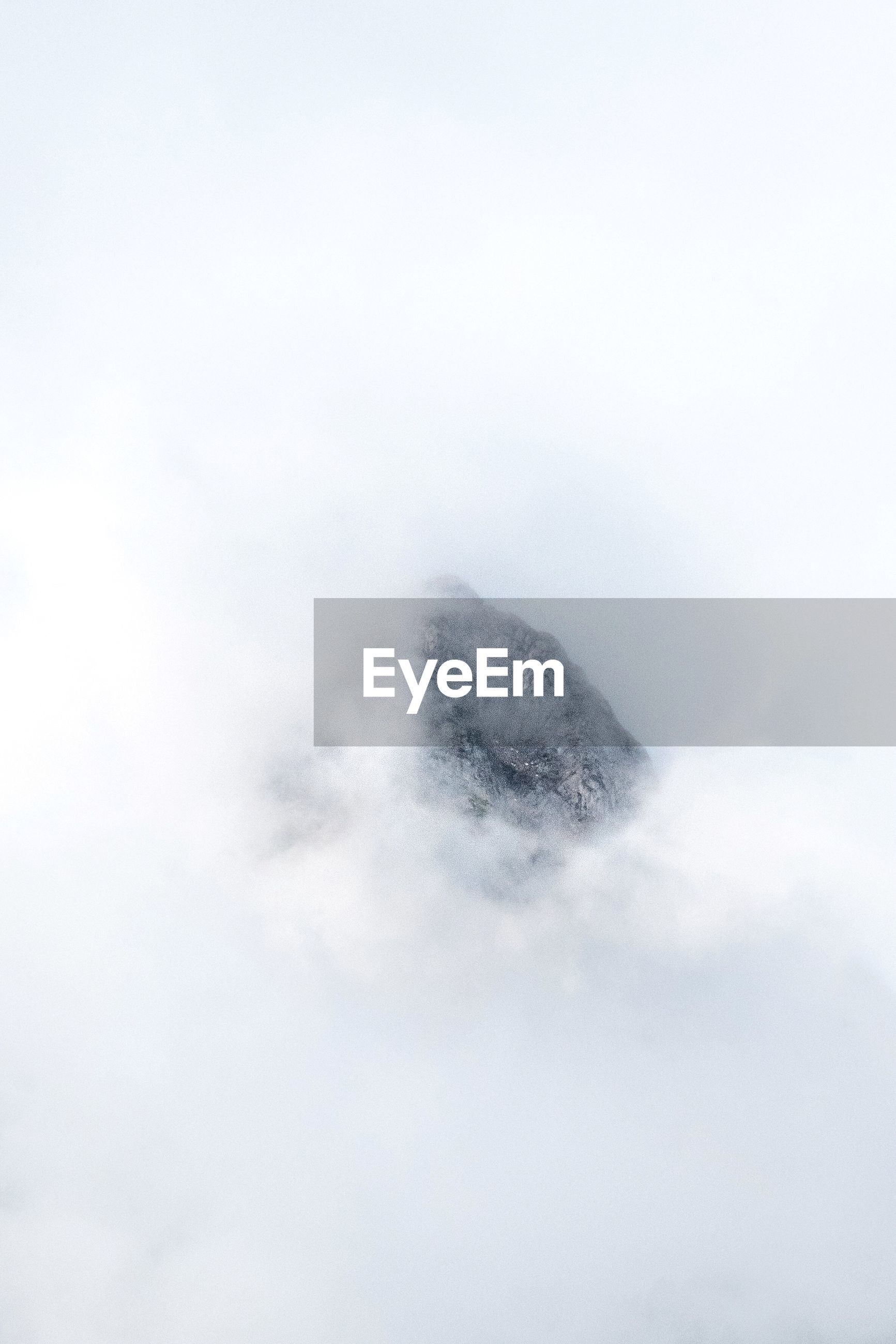 cloud - sky, sky, beauty in nature, no people, scenics - nature, nature, tranquility, tranquil scene, day, low angle view, outdoors, copy space, fog, idyllic, non-urban scene, mountain, cloudscape, white color, fluffy, mountain peak